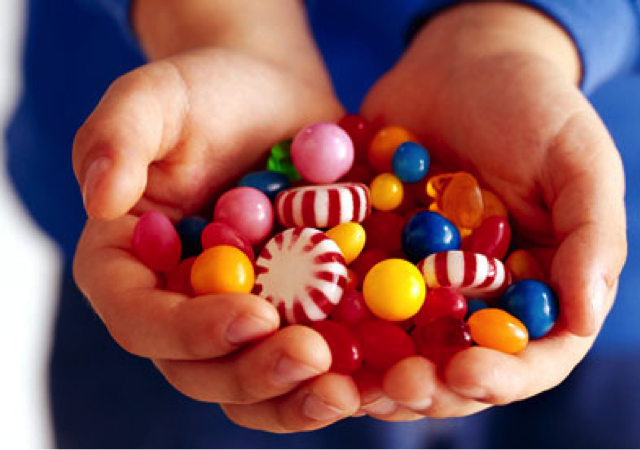 Childs-Hands-full-of-candy